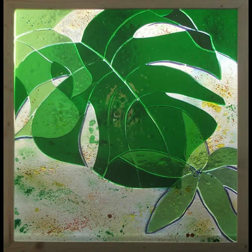 Monstera - stained glass panel by Jude Alderman